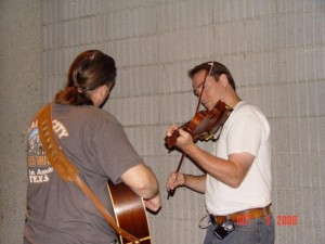 Vi Wickam (fiddle) warming up with Terry Ludiker (guitar)